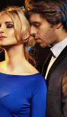 Handsome man seducing an elegant girl — Stock Photo