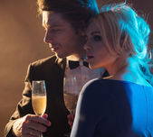 Elegant young couple drinking a champagne — Stock Photo