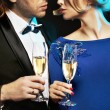Elegant couple drinking a champagne — Stock Photo #66890045