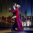 Couple dancing on the top of the skyscraper — Stock Photo #66892705