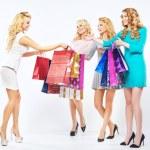 Four beautiful girls enjoying the shopping — Stock Photo #66896437