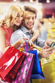 Cheerful people during the shopping — Stock Photo