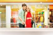 Elegant couple standing in the shopping mall — Stock Photo