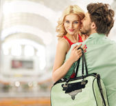 Optimistic couple spending leisure in a mall — Stock Photo