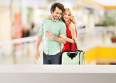 Happy, smiling couple in the mall — Stock Photo