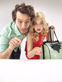 Amazed couple staring at sales — Stock Photo