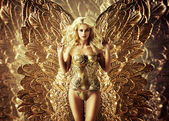Blond tempting woman with the golden wings — Stock Photo