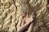 Conceptual portrait of a seductive lady wearing feather hat — Stock Photo