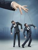 Conceptual picture of the human marionette — Stock Photo
