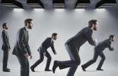 Conceptual picture of running businessmen — Stock Photo
