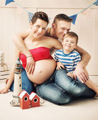 Portrait of a happy family expecting a new member — Stock Photo
