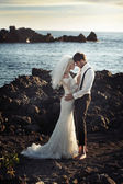 Young marriage couple over the ocean — Stock Photo