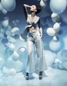 Fashion shot of a brunette woman among balloons — Stock Photo
