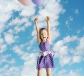 Little girl flying up to the sky — Stock Photo