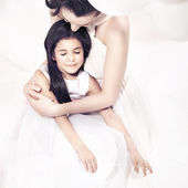Pretty mother hugging her daughter — Stock Photo