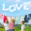 Cute brothers making a laundry — Stock Photo #73005389