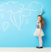 Cute girl making chalk drawings — Stock Photo