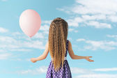 Little girl with a balloon — Stock Photo