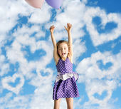 Little woman flying up to the sky — Stock Photo