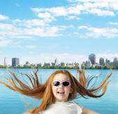 Ginger girl over the city background — Stock Photo