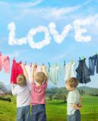 Cute brothers making a laundry — Stock Photo