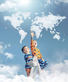 Two boys touching a world map — Stock Photo