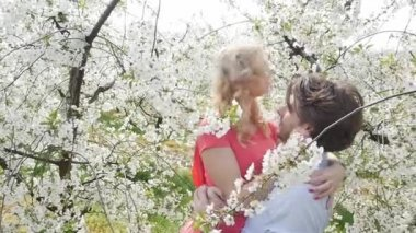 Cheerful couple enjoying leisure time in the orchard — Video Stock