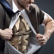 Conceptual picture of a man with golden chest — Stock Photo #74054213