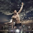 Successul man over the night city background — Stock Photo #74054645