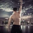 Fit athlete over the city background — Stock Photo #74054869