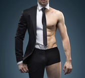 Conceptual image of muscular fit businessman — Stock Photo
