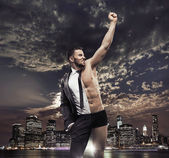 Succesful businessman over the city background — Stock Photo