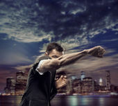 Successful man over the city background — Stock Photo