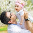 Happy father cuddling his cute daughter — Stock Photo #74089535