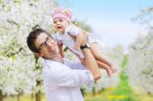 Cheerful father holding his beloved child — Stock Photo