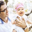 Cheerful father holding his lovely baby — Stock Photo #74090539
