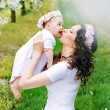Happy mother kissing her little princess — Stock Photo #74094717