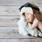 Cute little boy sleeping with goggles — Stock Photo