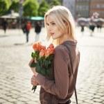 Joyful lady holding a bouquet of fresh roses — Stock Photo #74120981