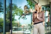 Charming girl holding a new generation cell phone — Stock Photo