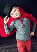 Little elegant magician boy touching his hat — Stock Photo