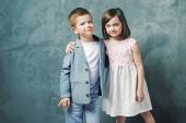 Adorable kids posing and hugging — Stock Photo