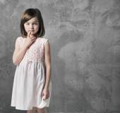 Portrait of a thoughtful little girl — Stock Photo