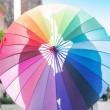 Couple hugging behind the umbrella — Stock Photo #77393424