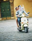 Handsome man riding a scooter with his girlfriend — Stock Photo