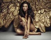 Portrait of a cute angel with gold wings — Stock Photo