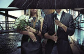 Portrait of the couple standing in the rain — Stock Photo