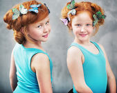Two ginger twins with butterflies in haircut — Stock Photo