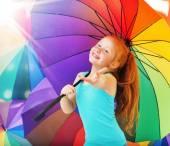 Cheerful girl with an umbrella — Stock Photo