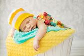 Cute baby sleeping in the basket — Stock Photo
